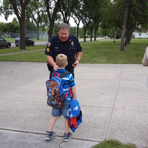Officer Volrath welcomes students