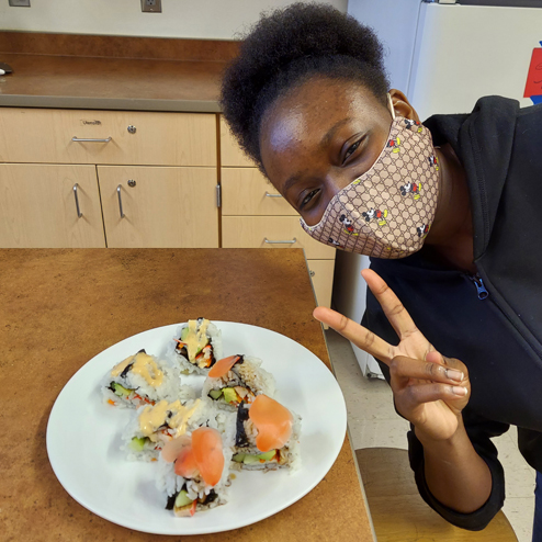 Student with plate of Sushi