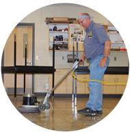 Custodian waxing a floor