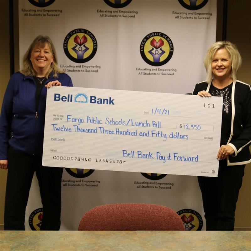 two women hold big check