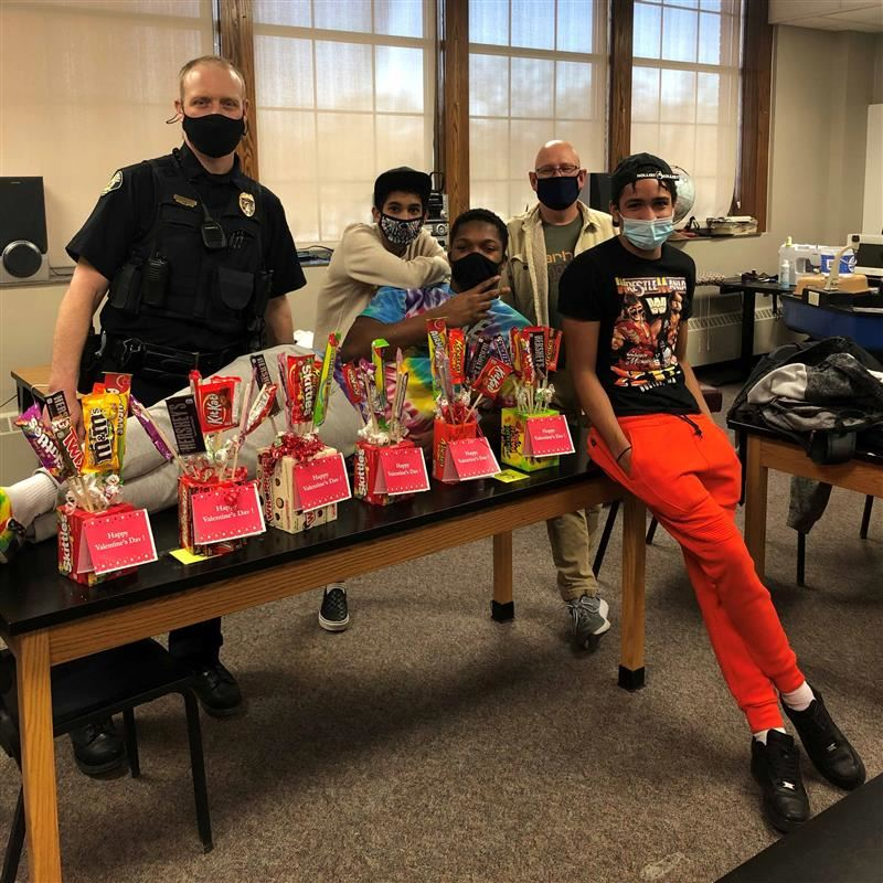 officer and students with candy bouquets