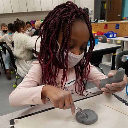 girl making clay art