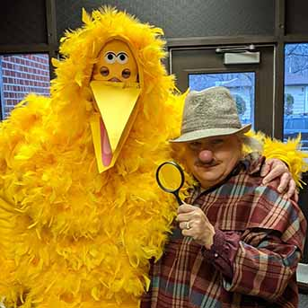 big bird and man with magnifying glass