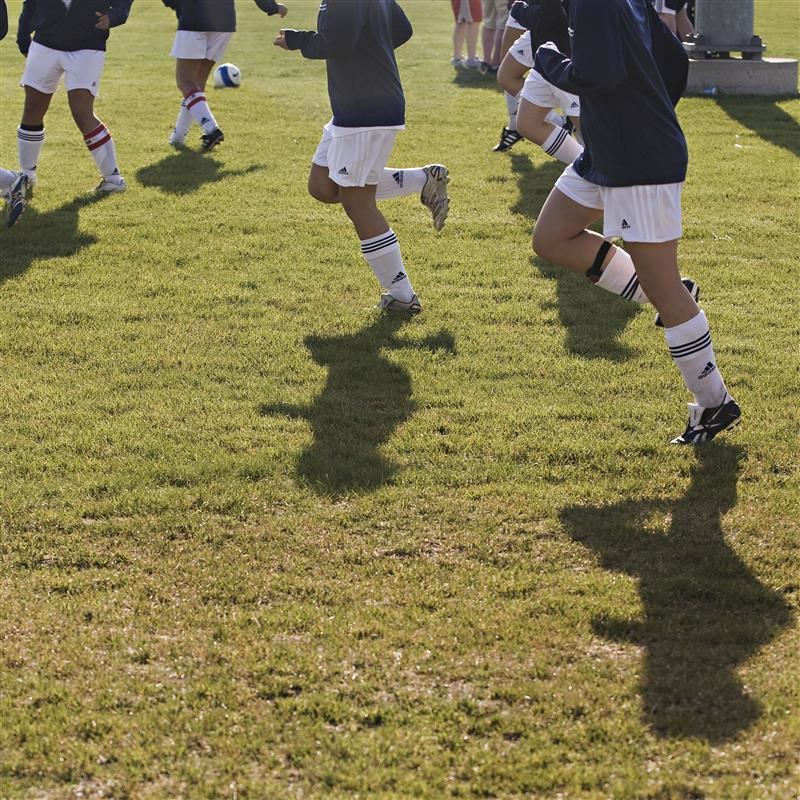 soccer players running