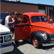 students look at inside of old fashioned car