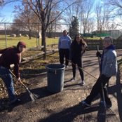 students outside raking
