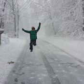 kid running in snow
