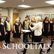 choir students singing in front of choral director